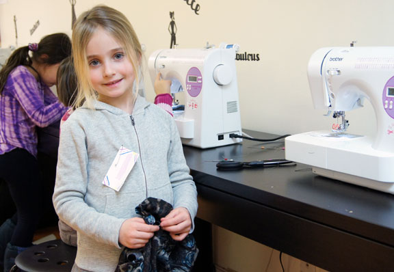 student-child-by-sewing-machine